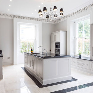 Inspiration for a large classic u-shaped kitchen in Other with shaker cabinets, an island, a submerged sink, grey cabinets and stainless steel appliances.