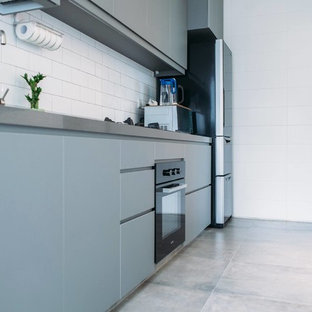 Design ideas for a mid-sized scandinavian kitchen in Singapore with a double-bowl sink, flat-panel cabinets, grey cabinets, quartz benchtops, white splashback, ceramic splashback, white appliances and ceramic floors.