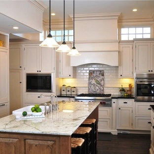 Large traditional eat-in kitchen pictures - Eat-in kitchen - large traditional u-shaped dark wood floor and brown floor eat-in kitchen idea in San Diego with a farmhouse sink, shaker cabinets, beige cabinets, granite countertops, white backsplash, subway tile backsplash, stainless steel appliances and an island