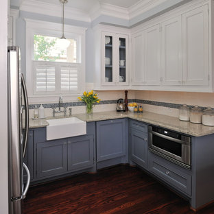 This is an example of a traditional kitchen in Houston with a farmhouse sink, blue cabinets, granite benchtops, white splashback, stainless steel appliances, subway tile splashback and recessed-panel cabinets.