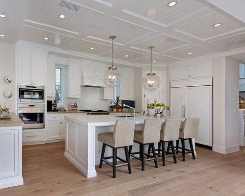 inspiration for a beach style u shaped kitchen remodel in orange county with shaker cabinets - Regina Kitchen Cabinets