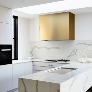 Design ideas for a contemporary u-shaped open plan kitchen in Melbourne with an undermount sink, marble benchtops, white splashback, marble splashback, black appliances, porcelain floors, no island, grey floor and white benchtop.