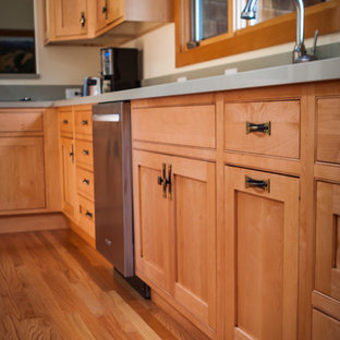 This is an example of a mid-sized arts and crafts l-shaped separate kitchen in San Francisco with a double-bowl sink, shaker cabinets, medium wood cabinets, quartzite benchtops, stainless steel appliances, medium hardwood floors and with island.