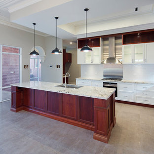 Inspiration for a mid-sized traditional galley open plan kitchen in Perth with a double-bowl sink, shaker cabinets, white cabinets, limestone benchtops, white splashback, subway tile splashback and with island.