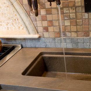 Mediterranean eat-in kitchen ideas - Inspiration for a mediterranean beige floor eat-in kitchen remodel in Los Angeles with a farmhouse sink, dark wood cabinets, beige backsplash and an island
