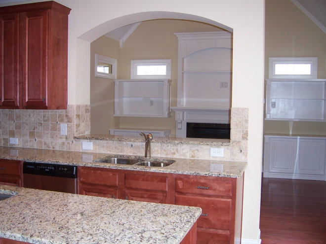Rustic Kitchen by AHB General Contractors