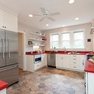 Photo of a scandinavian eat-in kitchen in Bridgeport with an undermount sink, shaker cabinets, white cabinets, quartz benchtops, white splashback, ceramic splashback, stainless steel appliances, porcelain floors, a peninsula and red benchtop.