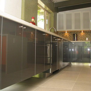 Mid-sized modern open concept kitchen ideas - Inspiration for a mid-sized modern l-shaped porcelain floor open concept kitchen remodel in Phoenix with a double-bowl sink, flat-panel cabinets, quartz countertops, multicolored backsplash, glass tile backsplash, stainless steel appliances and an island