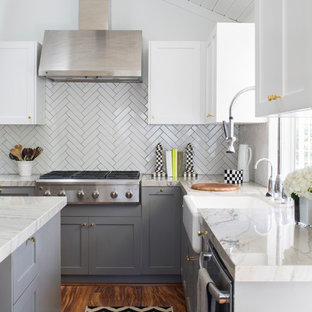 Photo of a mid-sized traditional u-shaped kitchen pantry in Los Angeles with a farmhouse sink, shaker cabinets, grey cabinets, quartz benchtops, white splashback, porcelain splashback, stainless steel appliances, medium hardwood floors and with island.