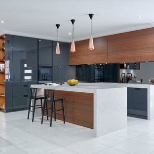 Inspiration for a mid-sized contemporary l-shaped eat-in kitchen in Other with flat-panel cabinets, mirror splashback, white floor, grey cabinets, panelled appliances and with island.