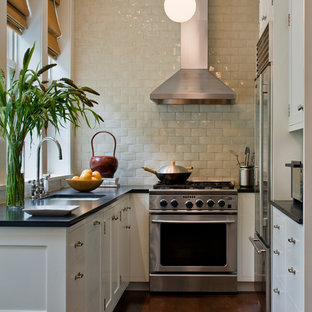 Inspiration for a small classic u-shaped enclosed kitchen in New York with white cabinets, beige splashback, a submerged sink, recessed-panel cabinets, soapstone worktops, metro tiled splashback, stainless steel appliances, dark hardwood flooring, no island and brown floors.
