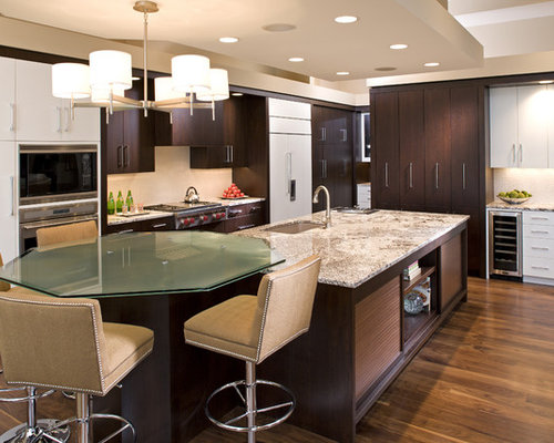 Trendy Kitchen Photo In Minneapolis With Flat Panel Cabinets And Dark Wood  Cabinets