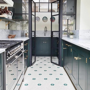 Inspiration for a transitional u-shaped separate kitchen in London with shaker cabinets, green cabinets, grey splashback and grey benchtop.