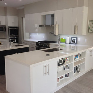 Example Of A Huge Minimalist U Shaped Porcelain Floor Open Concept Kitchen  Design In Miami