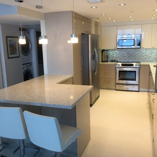 Mid-sized modern u-shaped kitchen pantry in Miami with an undermount sink, flat-panel cabinets, white cabinets, recycled glass benchtops, grey splashback, glass tile splashback, stainless steel appliances, porcelain floors and a peninsula.
