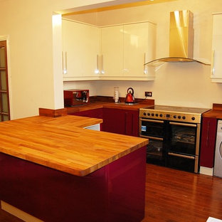 High Gloss bespoke kitchen with solid iroko tops
