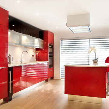 High gloss red kitchen with island