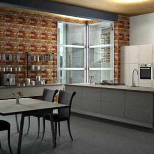 シャーロットの中くらいのインダストリアルスタイルのおしゃれなキッチン (ドロップインシンク、フラットパネル扉のキャビネット、ステンレスキャビネット、御影石カウンター、シルバーの調理設備、ラミネートの床、グレーの床、グレーのキッチンカウンター、表し梁) の写真