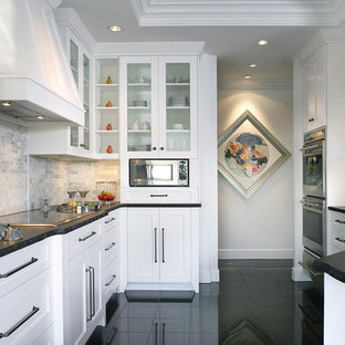 Inspiration for a small transitional galley eat-in kitchen in Miami with glass-front cabinets, white cabinets, granite benchtops, grey splashback, mosaic tile splashback, stainless steel appliances, marble floors, a peninsula and an undermount sink.