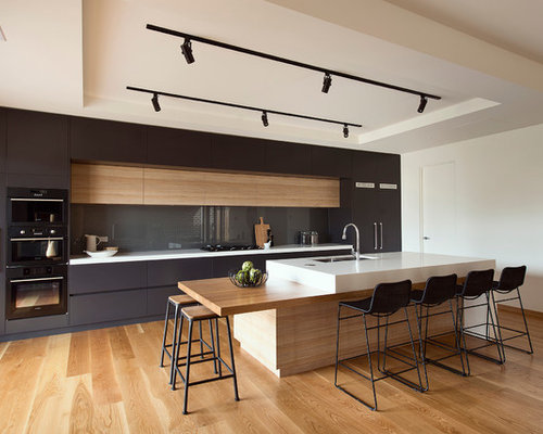 Kitchen   Mid Sized Modern Galley Medium Tone Wood Floor Kitchen Idea In  Melbourne With
