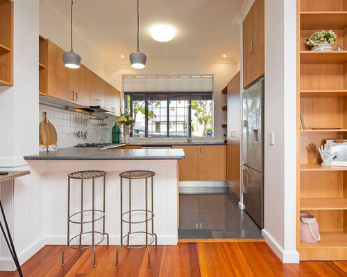 Inspiration For A Modern U Shaped Kitchen In Brisbane With Flat Panel  Cabinets,