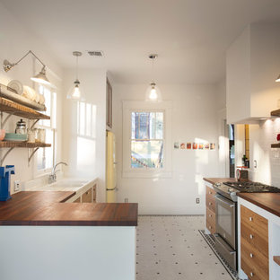 Example of an eclectic kitchen design in Austin with stainless steel appliances