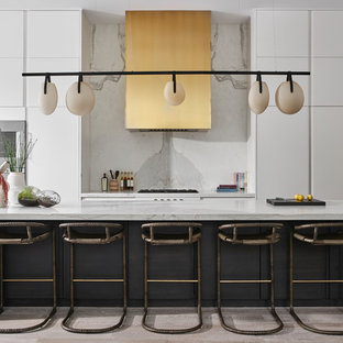 Contemporary eat-in kitchen remodeling - Inspiration for a contemporary galley light wood floor and beige floor eat-in kitchen remodel in Chicago with flat-panel cabinets, white cabinets, white backsplash, an island and white countertops