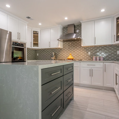 Large transitional u-shaped porcelain tile open concept kitchen photo in Los Angeles with a single-bowl sink, shaker cabinets, white cabinets, quartzite countertops, gray backsplash, porcelain backsplash, stainless steel appliances and an island