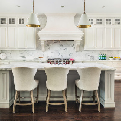 Inspiration for a timeless dark wood floor and brown floor kitchen remodel in Nashville with recessed-panel cabinets, white cabinets, white backsplash, stainless steel appliances, an island and white countertops