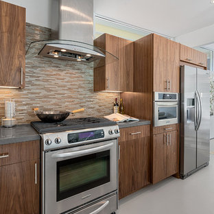 Midcentury modern eat-in kitchen ideas - 1950s single-wall eat-in kitchen photo in Los Angeles with granite countertops, multicolored backsplash, matchstick tile backsplash, stainless steel appliances, flat-panel cabinets and dark wood cabinets