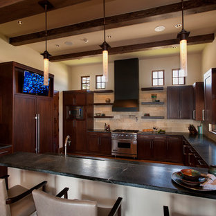 Inspiration for a mid-sized contemporary u-shaped separate kitchen in Austin with an undermount sink, shaker cabinets, dark wood cabinets, onyx benchtops, beige splashback, stone tile splashback, panelled appliances, medium hardwood floors and a peninsula.