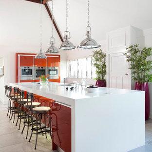 ベルファストの大きいコンテンポラリースタイルのおしゃれなキッチン (フラットパネル扉のキャビネット、オレンジのキャビネット、人工大理石カウンター、白いキッチンパネル、シルバーの調理設備の、セラミックタイルの床、グレーの床) の写真