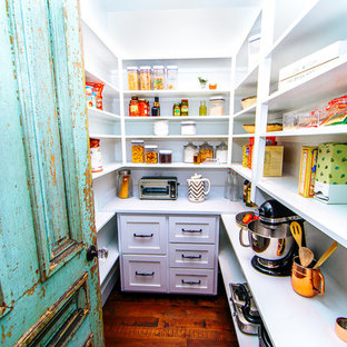 Inspiration for a large rural u-shaped kitchen pantry in Austin with shaker cabinets, white cabinets, granite worktops, white splashback, stainless steel appliances, bamboo flooring, brown floors and white worktops.