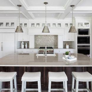 Coastal kitchen photo in Minneapolis with shaker cabinets, white cabinets, metallic backsplash, metal backsplash, paneled appliances and an island