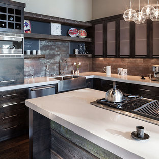 Inspiration for a large contemporary l-shaped dark wood floor eat-in kitchen remodel in Portland with stainless steel appliances, a farmhouse sink, quartz countertops, flat-panel cabinets, dark wood cabinets, metallic backsplash, porcelain backsplash and an island