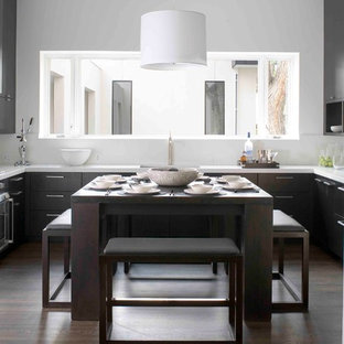 Example of a trendy u-shaped enclosed kitchen design in Denver with flat-panel cabinets and dark wood cabinets