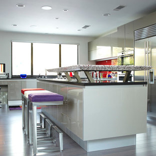 Large contemporary open concept kitchen remodeling - Large trendy l-shaped dark wood floor open concept kitchen photo in Houston with an undermount sink, flat-panel cabinets, recycled glass countertops, red backsplash, metal backsplash, white appliances and an island