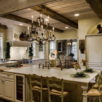 Elegant kitchen photo in Chicago with raised-panel cabinets, white cabinets, white backsplash and paneled appliances