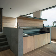Contemporary Kitchen by RHYZOMA - Arquitectura / Diseño
