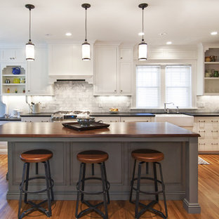 Rustic kitchen designs - Mountain style kitchen photo in Minneapolis with a farmhouse sink and wood countertops
