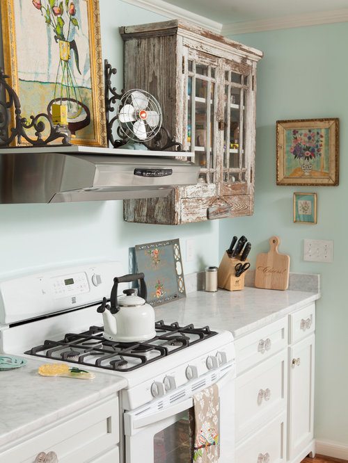 salvaged kitchen cabinets. Elegant enclosed kitchen photo in Wilmington with marble countertops  white appliances and distressed cabinets Salvaged Cabinet Houzz