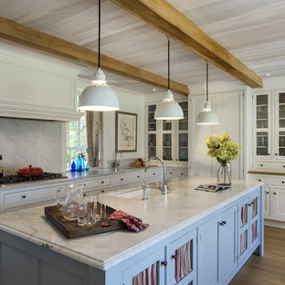 Farmhouse eat-in kitchen designs - Eat-in kitchen - cottage eat-in kitchen idea in New York with an undermount sink, shaker cabinets, white cabinets, marble countertops, white backsplash, stone slab backsplash and paneled appliances