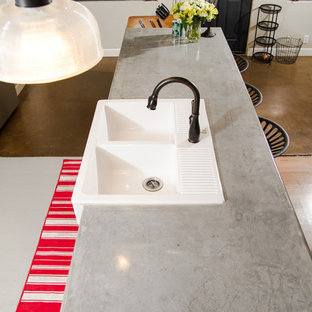 Design ideas for a small country galley eat-in kitchen in Phoenix with a farmhouse sink, shaker cabinets, white cabinets, concrete benchtops, grey splashback, cement tile splashback, stainless steel appliances, painted wood floors, with island and grey floor.