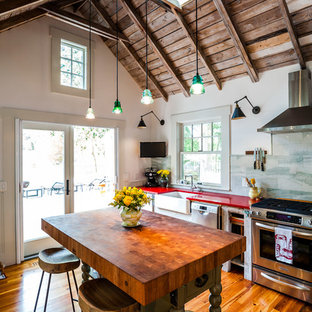 Small farmhouse kitchen photos - Inspiration for a small farmhouse dark wood floor kitchen remodel in Raleigh with open cabinets, an island, a farmhouse sink and stainless steel appliances