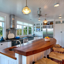 Beach Style Kitchen by Herlong and Associates Interiors