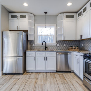 Photo of a small transitional u-shaped eat-in kitchen in Austin with an undermount sink, shaker cabinets, white cabinets, granite benchtops, white splashback, mosaic tile splashback, stainless steel appliances, porcelain floors and no island.