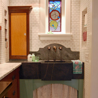 Photo of a traditional kitchen in Chicago with an integrated sink, white splashback and subway tile splashback.