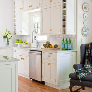 Farmhouse kitchen designs - Inspiration for a farmhouse medium tone wood floor and brown floor kitchen remodel in Other with an undermount sink, shaker cabinets, white cabinets and stainless steel appliances