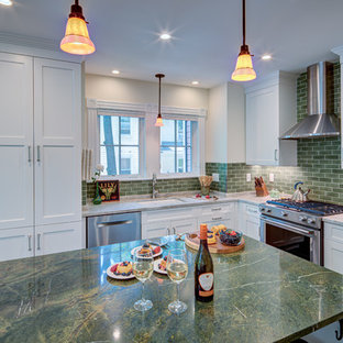 Large transitional u-shaped open plan kitchen in DC Metro with an undermount sink, shaker cabinets, white cabinets, marble benchtops, green splashback, subway tile splashback, stainless steel appliances, slate floors, with island, black floor and green benchtop.
