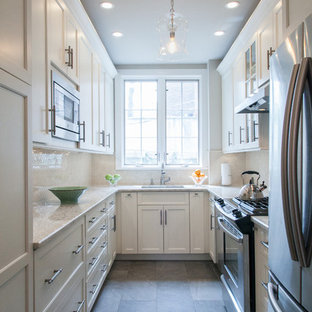 Example of a classic u-shaped enclosed kitchen design in Philadelphia with shaker cabinets, white cabinets, white backsplash and no island